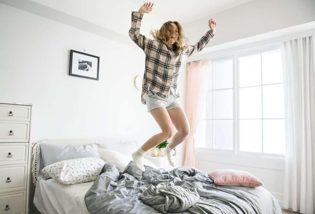 Girl jumping on new mattress
