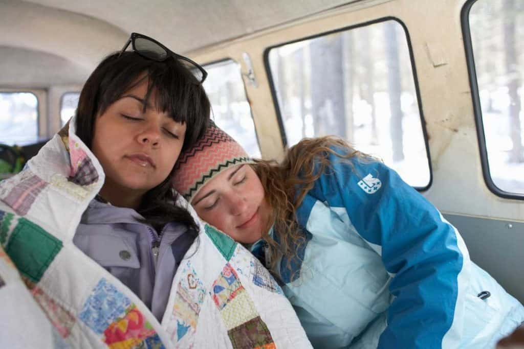 Young women sleeping in van