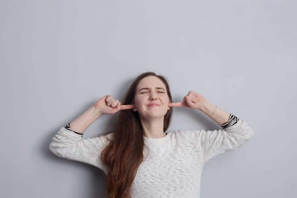 woman plugging ears
