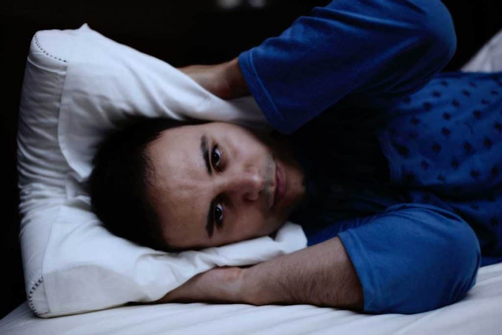 man cannot sleep in bed