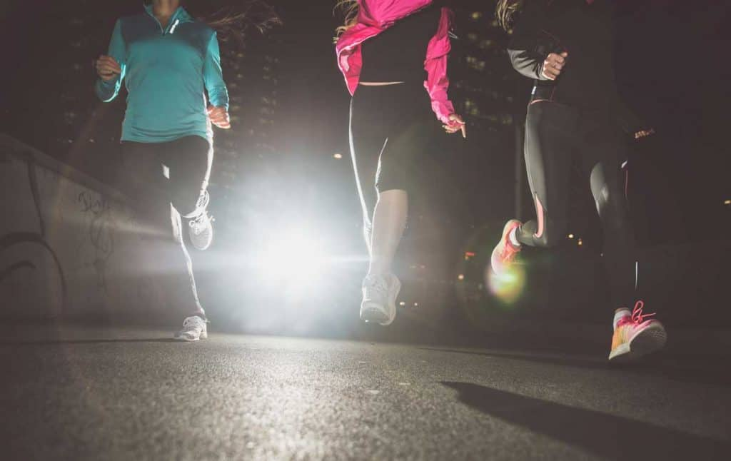 three people running as they exercise in the evening, What's the best time to exercise for better sleep for you? For some people it's on mornings