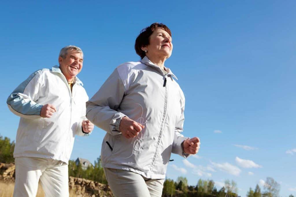 old senior man and woman jogging
