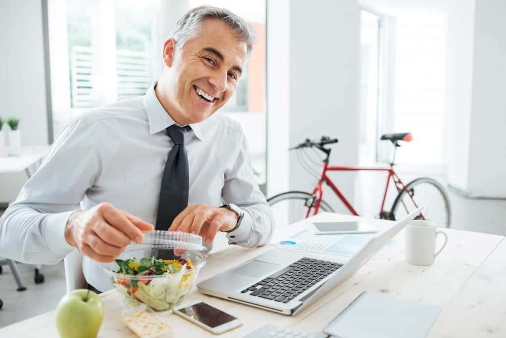 senior man eating healthy at work