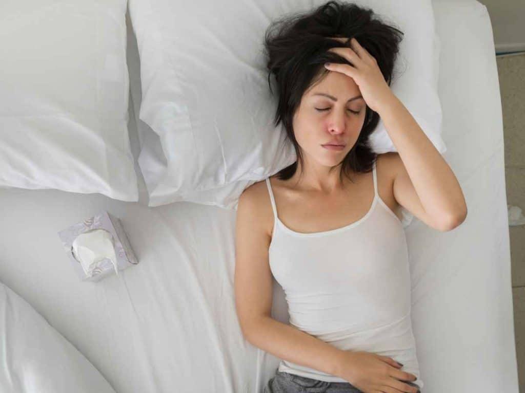Girl sleeping on bed prevent migraine