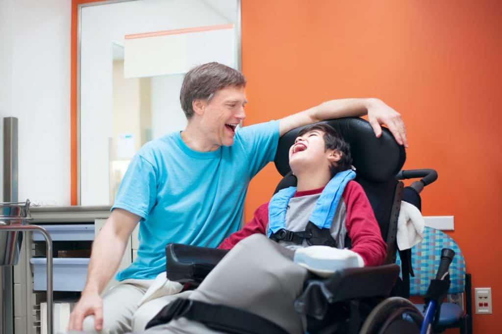 father and boy with cerebral palsy in hospital