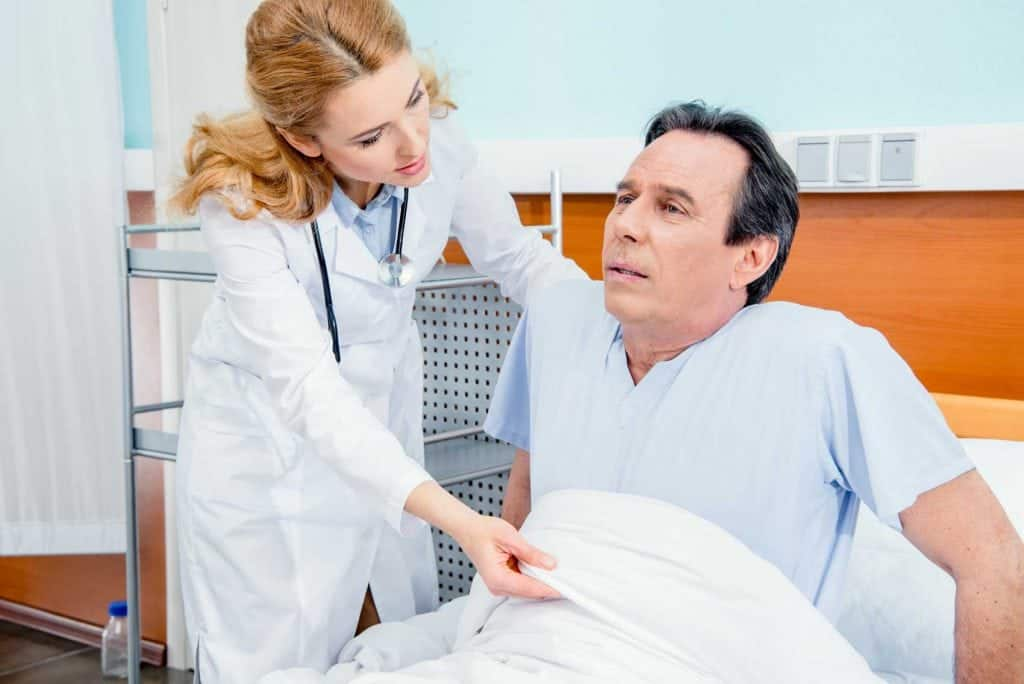 senior man with pain mnd with doctor